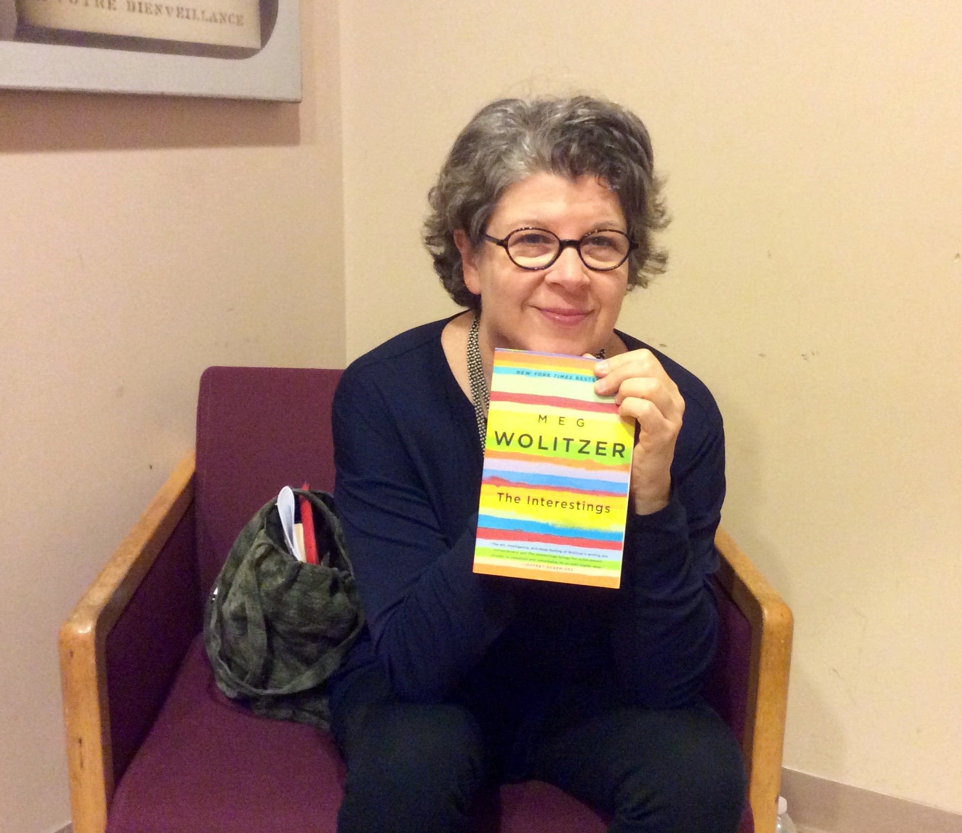 "Photo by Christina Cardona Meg Wolitzer holding a copy of her latest book titled ""The Interestings"""