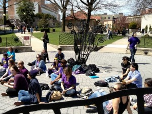 "Photo Courtesy of GLASA On April 17, GLASA and students participated in ""Day of Silence"" by wearing purple and covering their mouths with masking tape in Klapper Circle ."