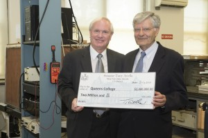 Photo courtesy of Aisha Hassan  With a $2 million check in hand, state Senator Tony Avella poses with former interim President Evangelos Gizis in a lab of Remsen Hall.