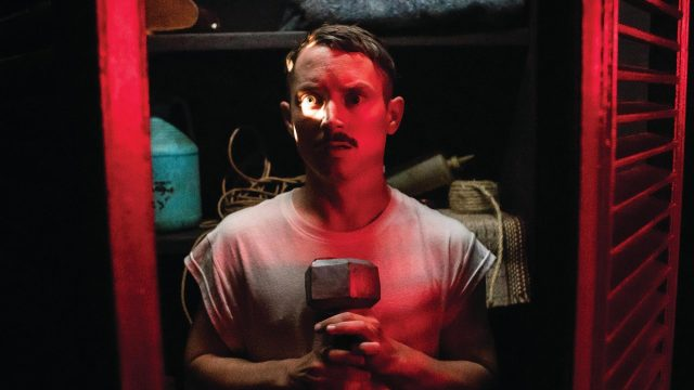 Caption: Elijah Wood Is Hilarious In Bloody Father-Son Comedy Photo Credit:https://www.indiewire.com