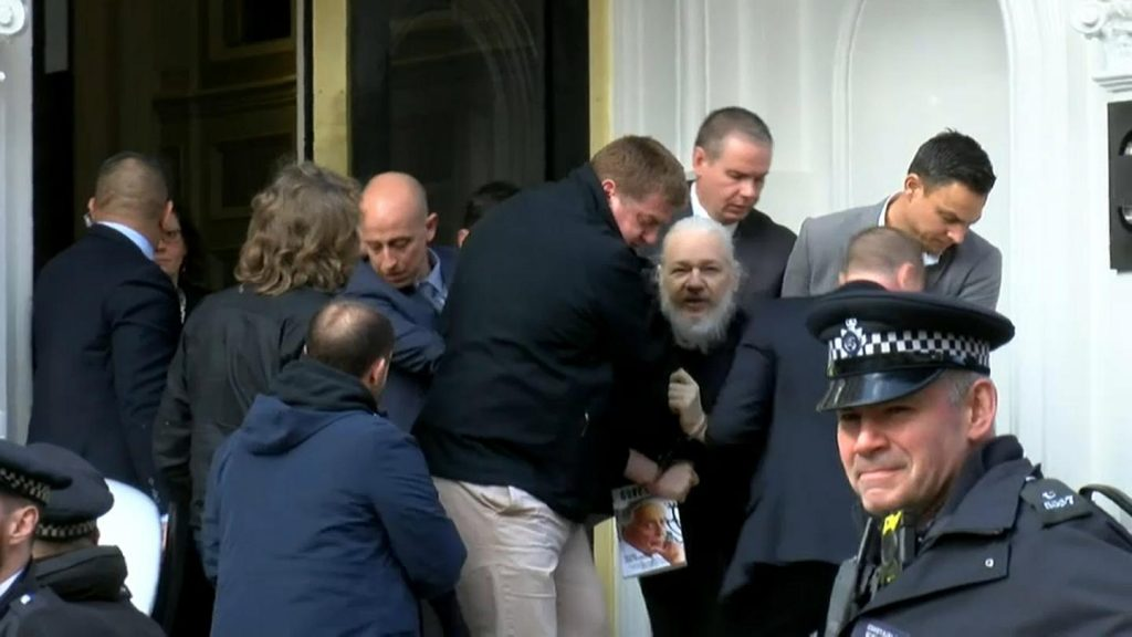 Photo Credit: Jack Taylor Getty Images Caption: Assange, arrested and on his way to jail.