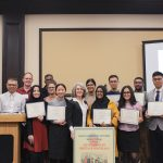 Credit: Asian-American Center Caption: Scholarship recipients pose with their scholarships, along with the Directors of the Asian-American Center.