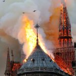 Credit: New York Times Caption: The spire of the Notre Dame Cathedral burning.